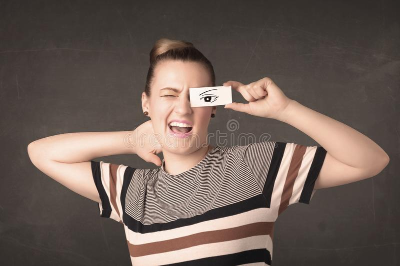 Silly youngster looking with hand drawn eye paper. Concept royalty free stock images