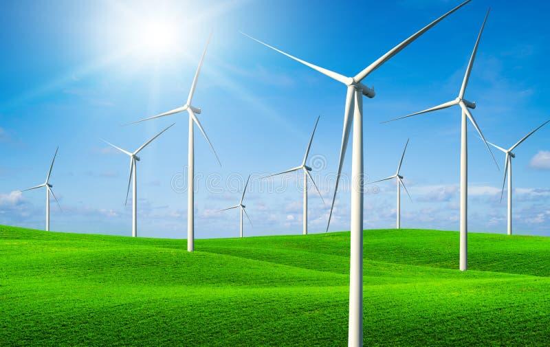 Silnika wiatrowego gospodarstwo rolne na zielonej trawy wzg?rzach zdjęcie royalty free