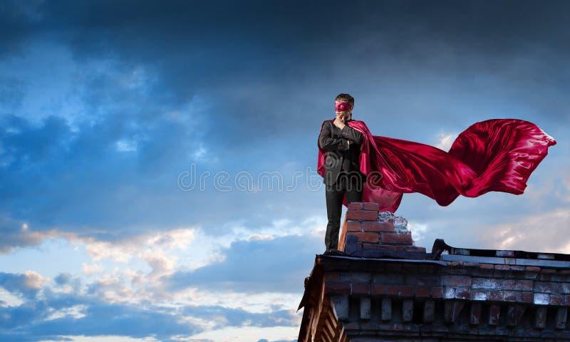 Silny i potężny jako super bohater Mieszani środki obrazy stock