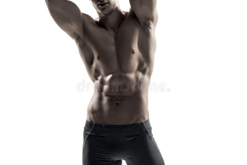 Silny mężczyzna pokazuje perfect ciała, abs i klatki piersiowej zakończenie, fotografia stock