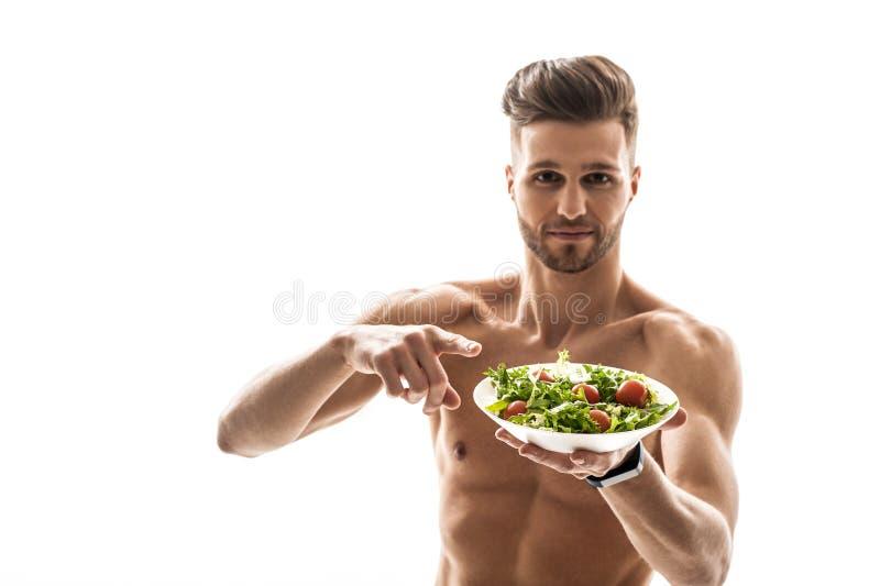Silny sportowiec woli zdrowego jedzenie zdjęcia stock