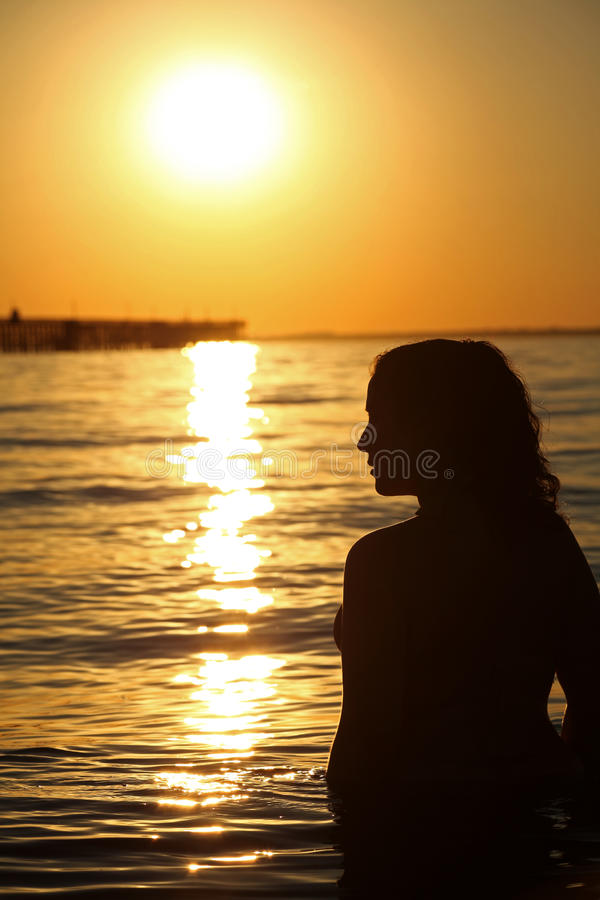 Silohoutte of Woman and sunset royalty free stock photography
