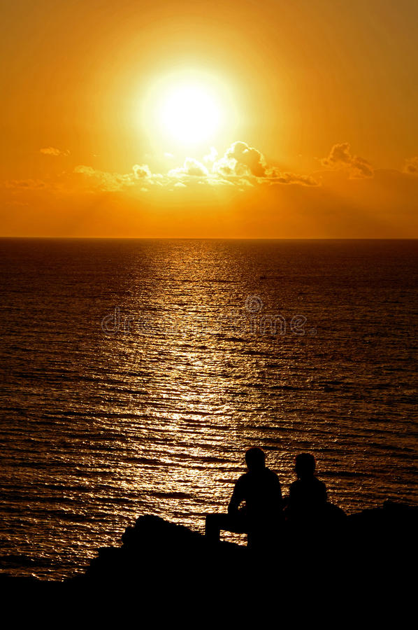 Download Silohuetted People Over A Sunset In The Atlantic Ocean Stock Image - Image: 31434351