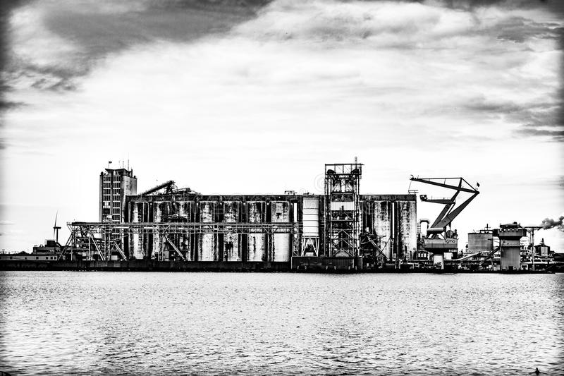 Silos in a industrial harbour royalty free stock photography