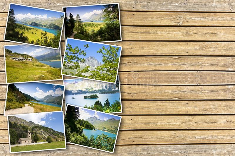 Sils lake in the Upper Engadine Valley in a summer day Europe - Switzerland - Postards concept on wooden background.  royalty free stock images