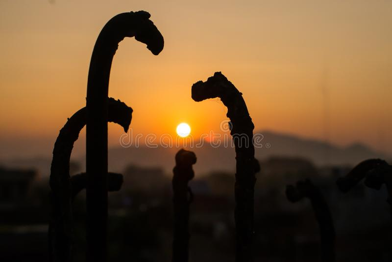 Siluet iron and sunset background stock photography