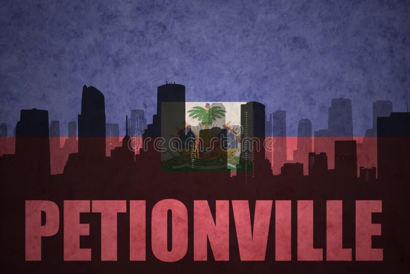 Silueta abstracta de la ciudad con el texto Petionville en la bandera del haitian del vintage fotos de archivo