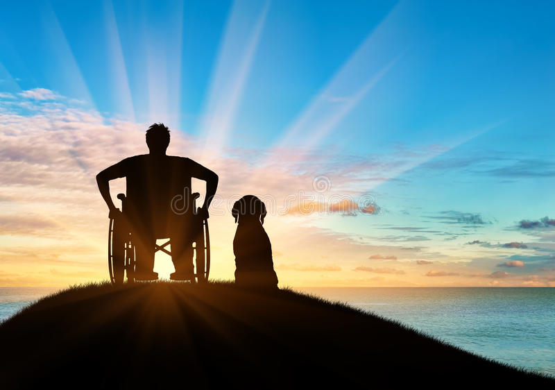 Silueta de discapacitado y del perro imagenes de archivo