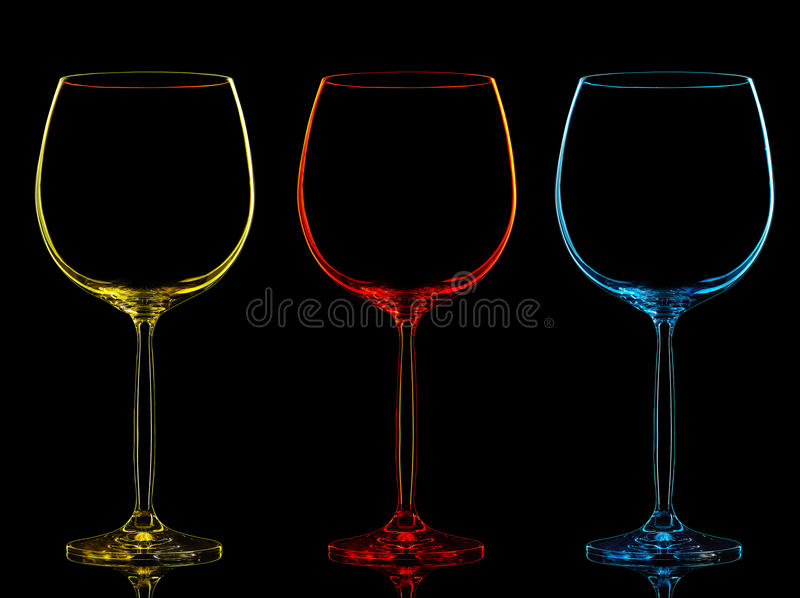Silueta de la copa de vino del color en negro fotografía de archivo libre de regalías