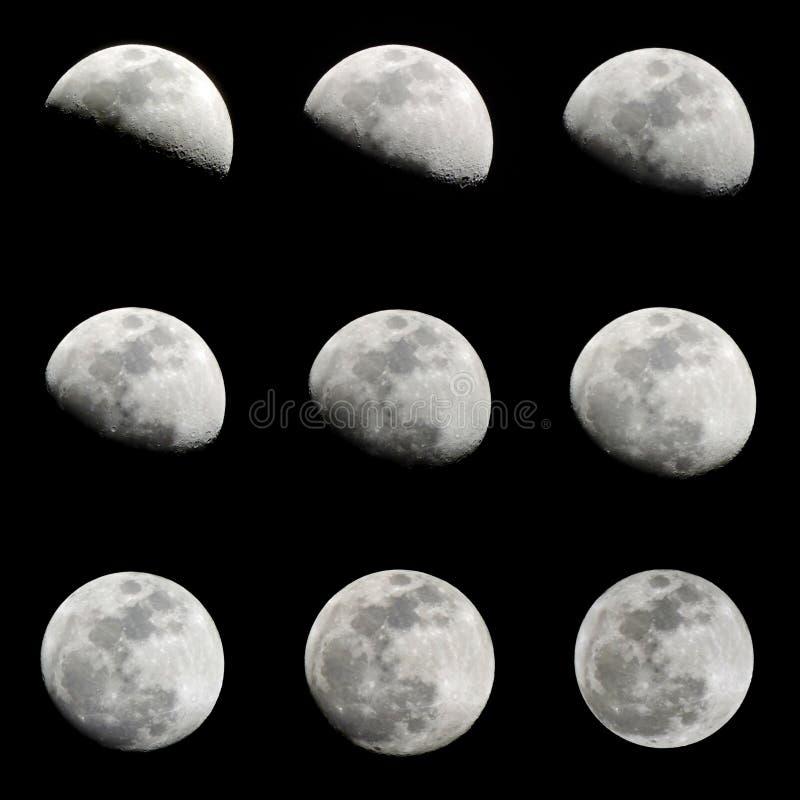 Silueta de la luna de 9 crecientes aislada en fondo negro imagen de archivo