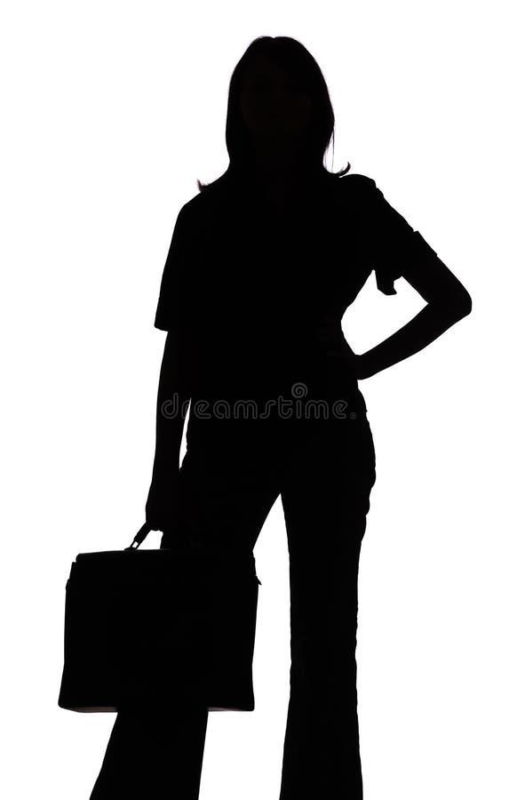 Silueta de la mujer con la maleta fotos de archivo libres de regalías