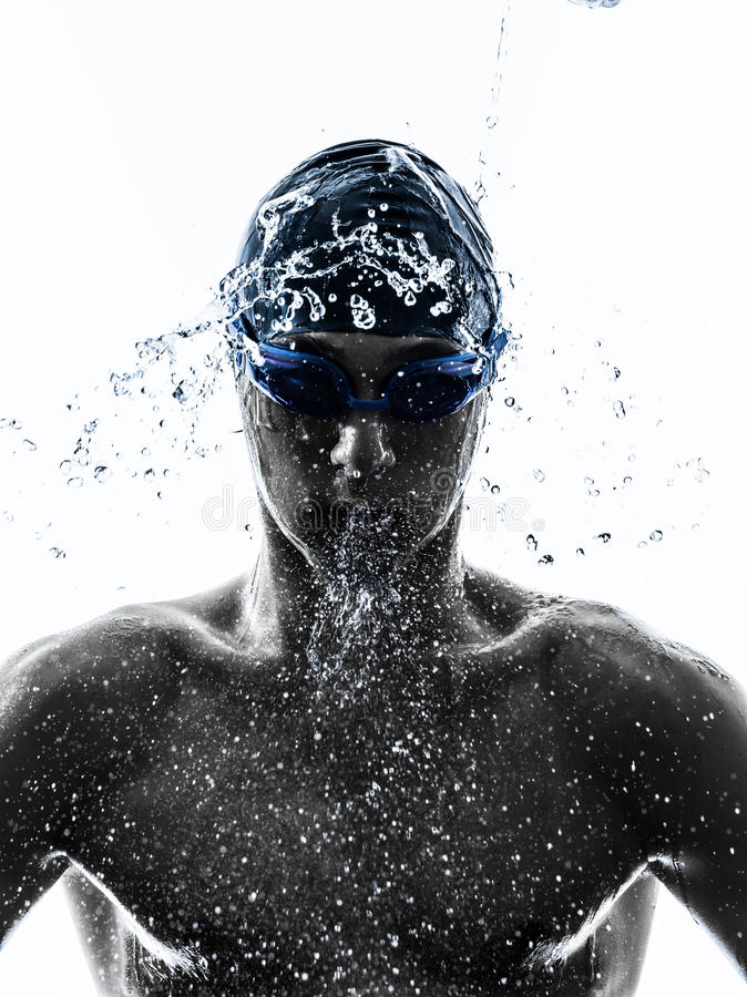 Silueta de la natación del nadador del hombre joven fotos de archivo libres de regalías