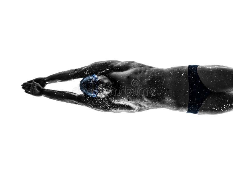 Silueta de la natación del nadador del hombre joven foto de archivo