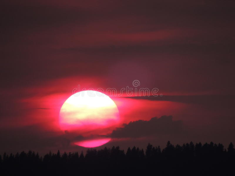 Silueta de la puesta del sol fotos de archivo libres de regalías