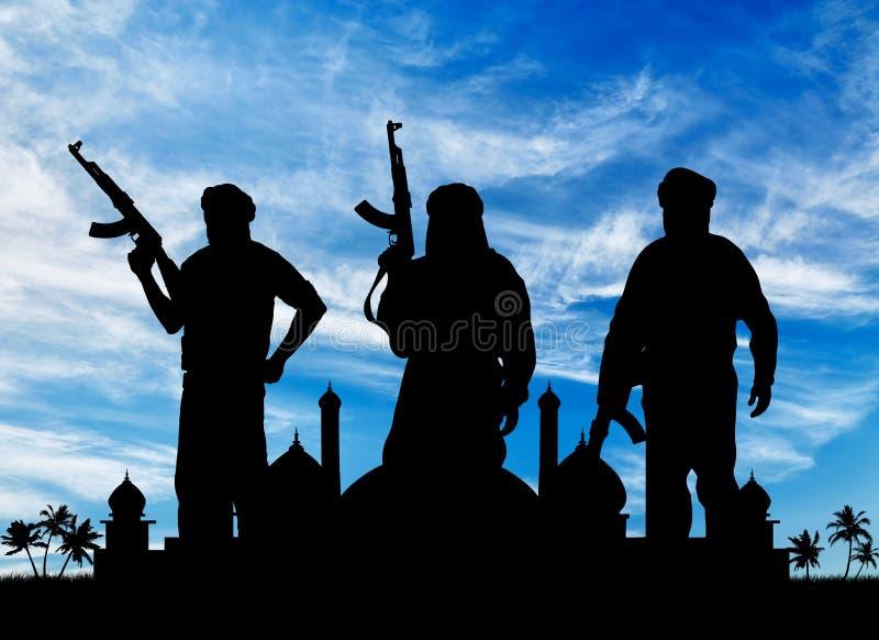 Silueta de tres terroristas imagen de archivo