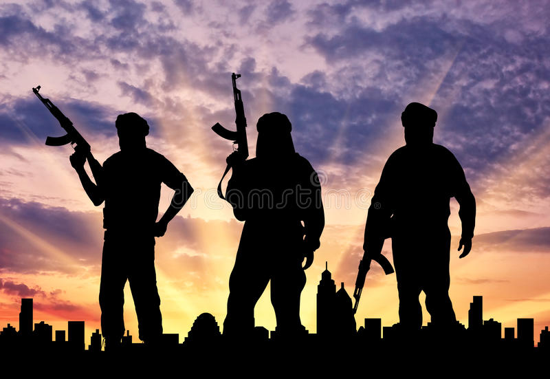 Silueta de tres terroristas fotos de archivo libres de regalías