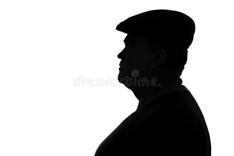 Silueta de un hombre regordete en un casquillo imagenes de archivo