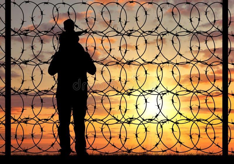 Silueta de un refugiado de la familia fotografía de archivo libre de regalías