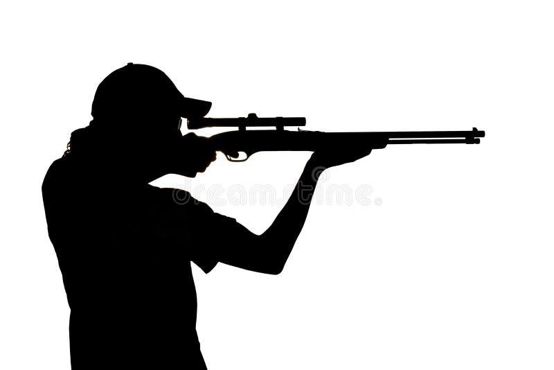 Silueta De Un Shooting Del Hombre Joven Foto De Archivo