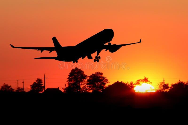 Silueta del aeroplano fotos de archivo