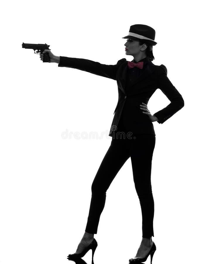 Silueta del asesino del gángster del arma de la mujer fotografía de archivo