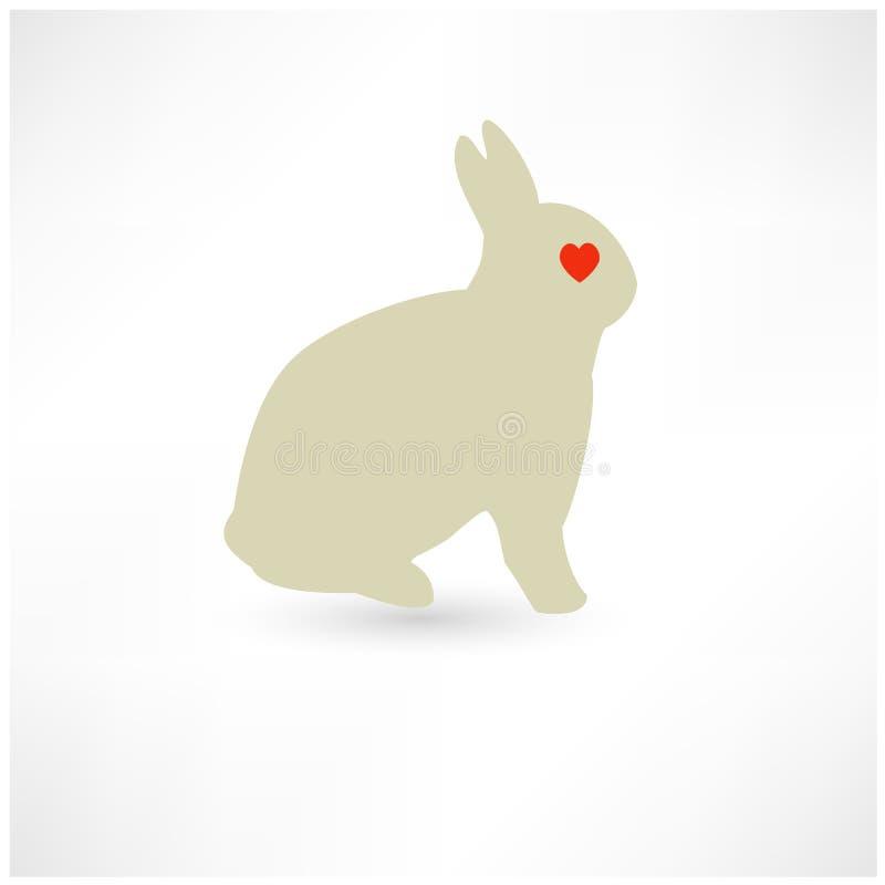 Silueta del conejito del conejo de Pascua con forma del corazón fotos de archivo libres de regalías