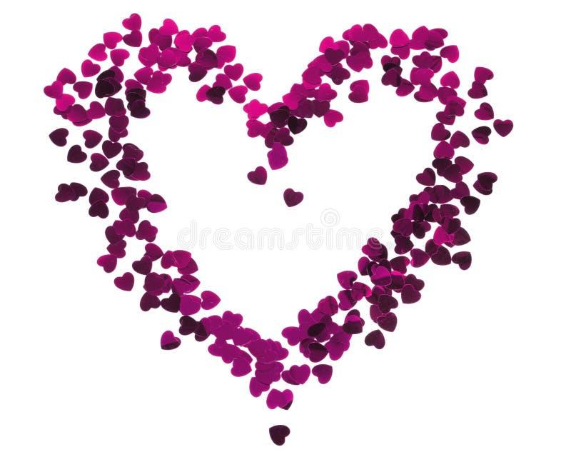 Silueta del corazón hecha de confeti rojo Tarjeta de las tarjetas del día de San Valentín imagenes de archivo