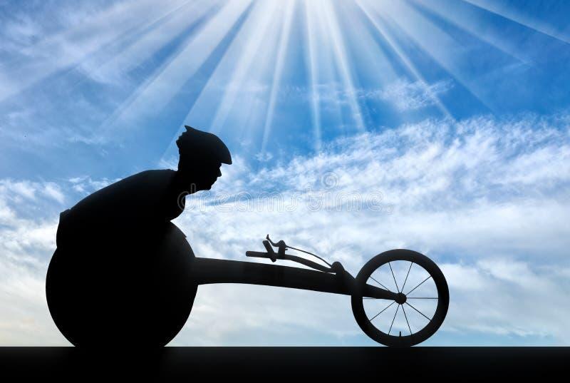 Silueta del deportista inhabilitada en una silla de ruedas que compite con imagen de archivo
