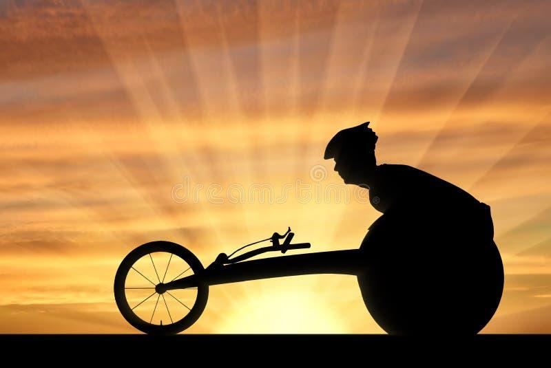 Silueta del deportista inhabilitada en una silla de ruedas que compite con fotografía de archivo