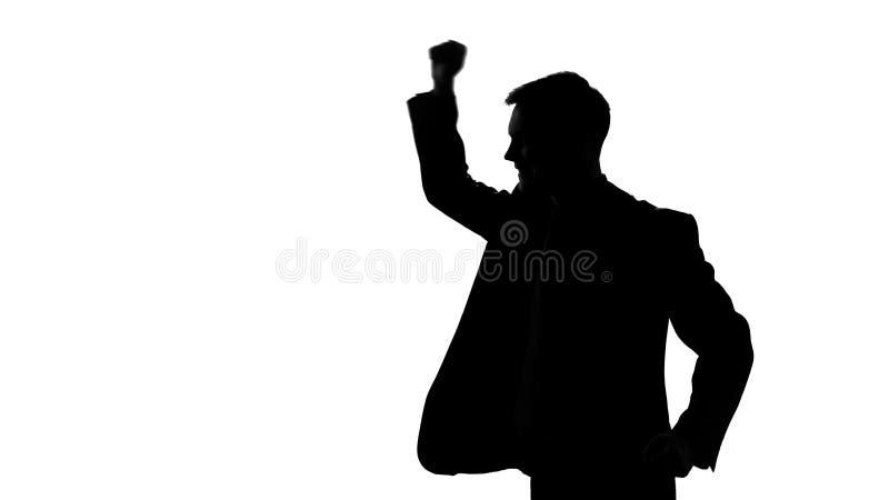 Silueta del encargado que aumenta los puños para arriba, plan empresarial acertado, buen negocio foto de archivo libre de regalías
