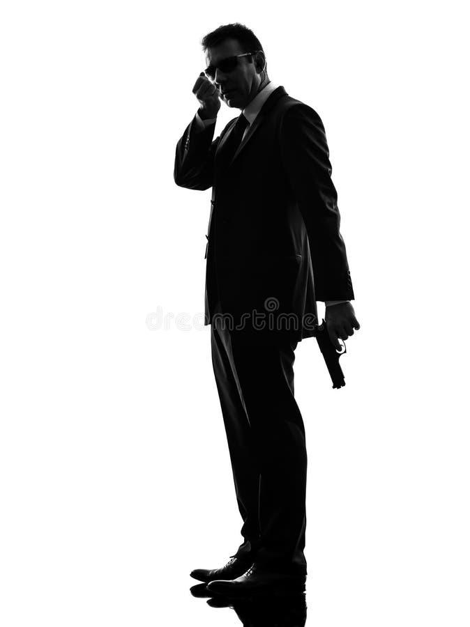 Silueta del hombre del agente del escolta de la seguridad del servicio secreto imagen de archivo