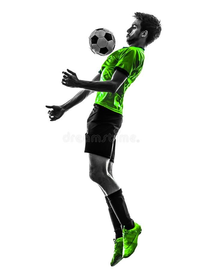 Silueta del hombre joven del futbolista del fútbol imagenes de archivo