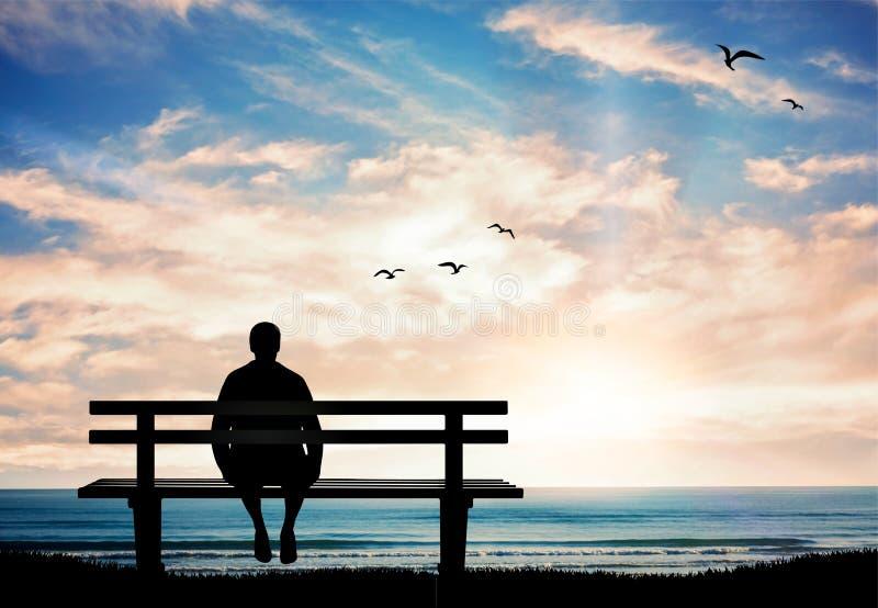 Silueta del hombre que se sienta solamente en el banco en la puesta del sol y el pensamiento fotografía de archivo libre de regalías