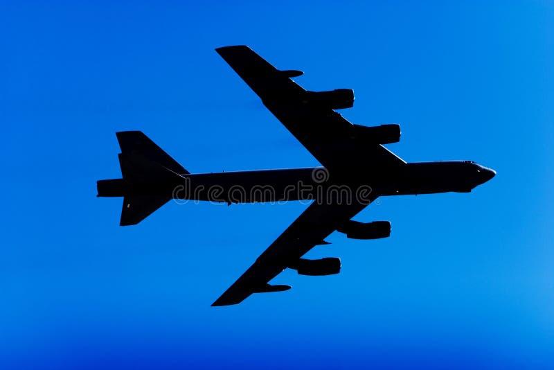 Silueta del jet del bombardero B-52 imágenes de archivo libres de regalías
