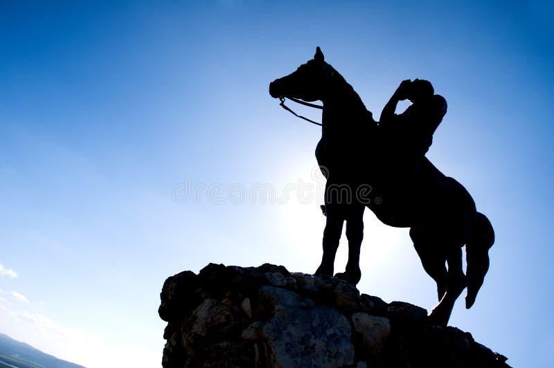Silueta del jinete del caballo imagenes de archivo