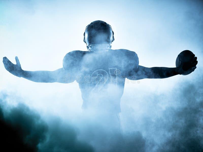 Silueta del jugador de fútbol americano imágenes de archivo libres de regalías