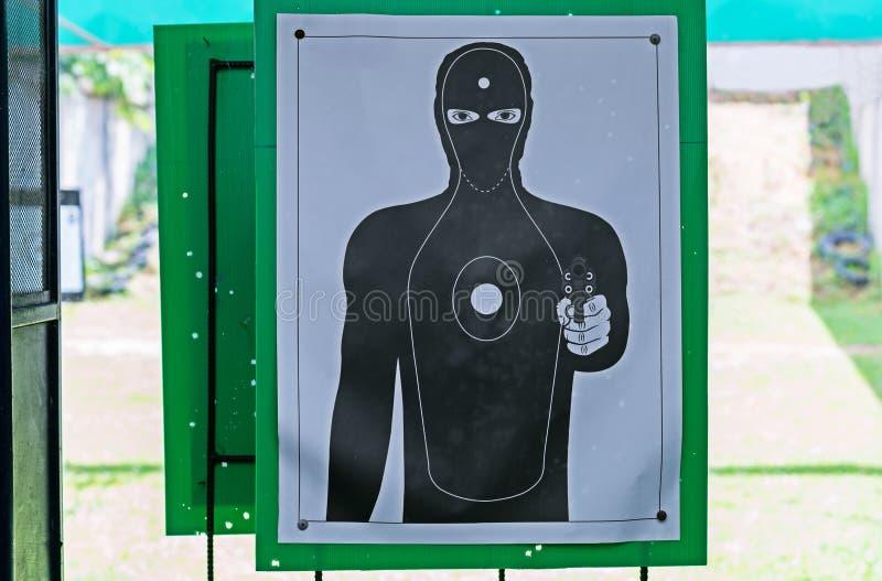 Silueta del negro de la blanco del hombre mejor para apuntar practicante La blanco humana negra del tiroteo de la arma de mano qu imágenes de archivo libres de regalías