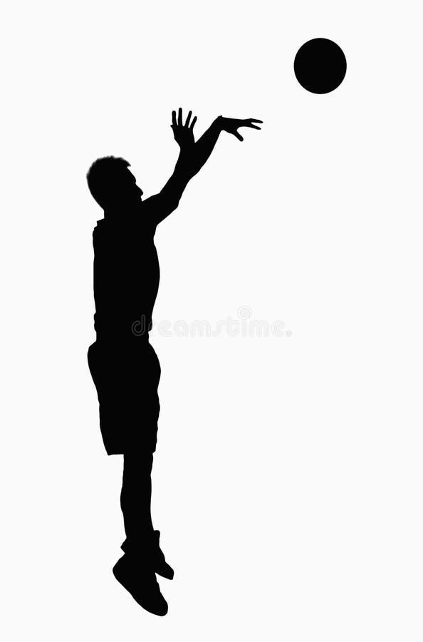 Silueta del salto del jugador de básquet. fotos de archivo
