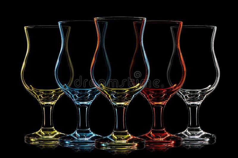 Silueta del vidrio de cóctel multicolor en negro fotografía de archivo libre de regalías
