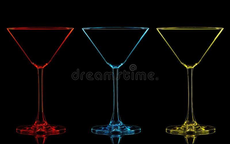 Silueta del vidrio de martini del color en negro foto de archivo libre de regalías