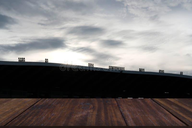 Silueta y luz del sol de la arena del estadio del deporte imagen de archivo libre de regalías