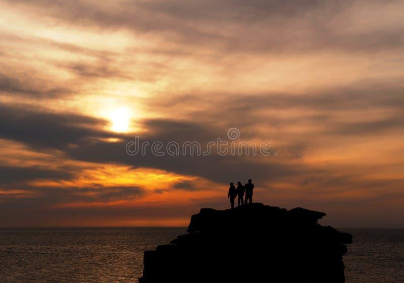 Siluetas de la puesta del sol foto de archivo libre de regalías