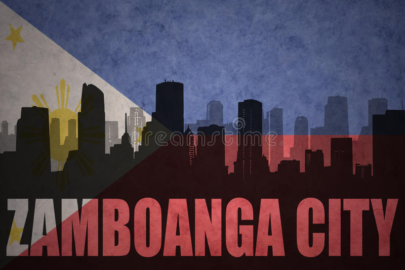 Siluetta astratta della città con la città di Zamboanga del testo alla bandiera d'annata di Filippine fotografia stock libera da diritti