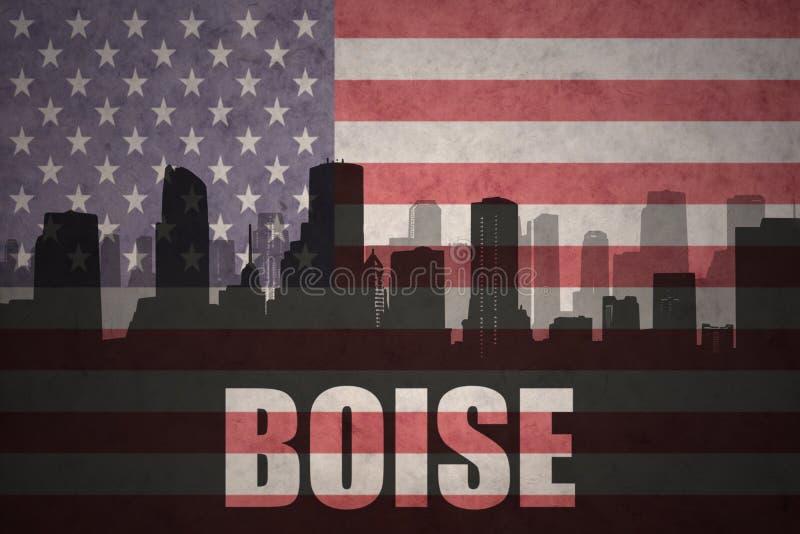 Siluetta astratta della città con testo Boise alla bandiera americana d'annata immagine stock