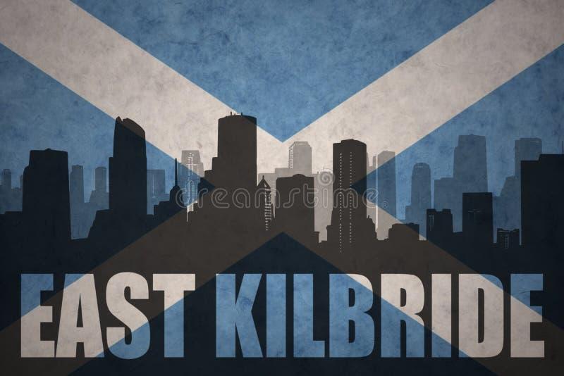 Siluetta astratta della città con testo orientale - kilbride alla bandiera d'annata della Scozia fotografia stock