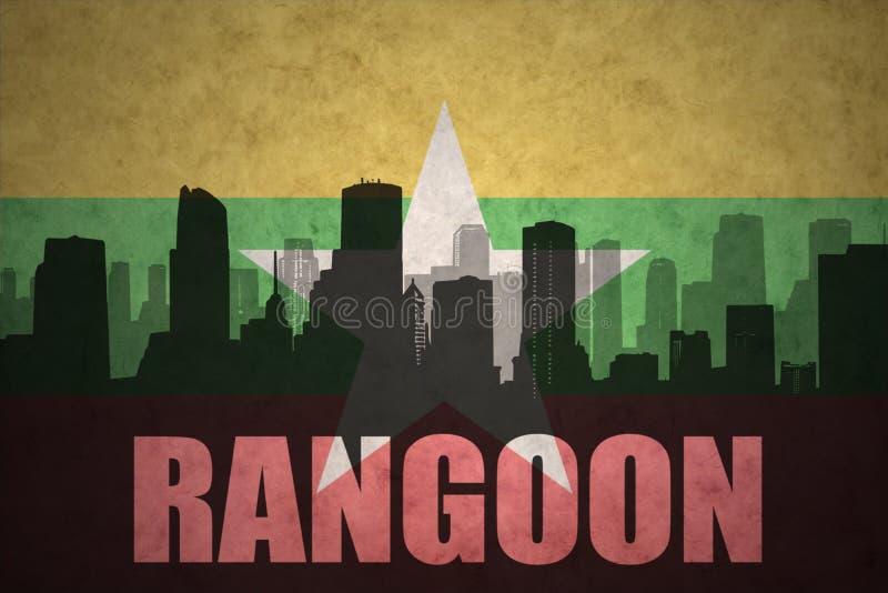 siluetta astratta della città con testo Rangoon alla bandiera d'annata di myanmar royalty illustrazione gratis