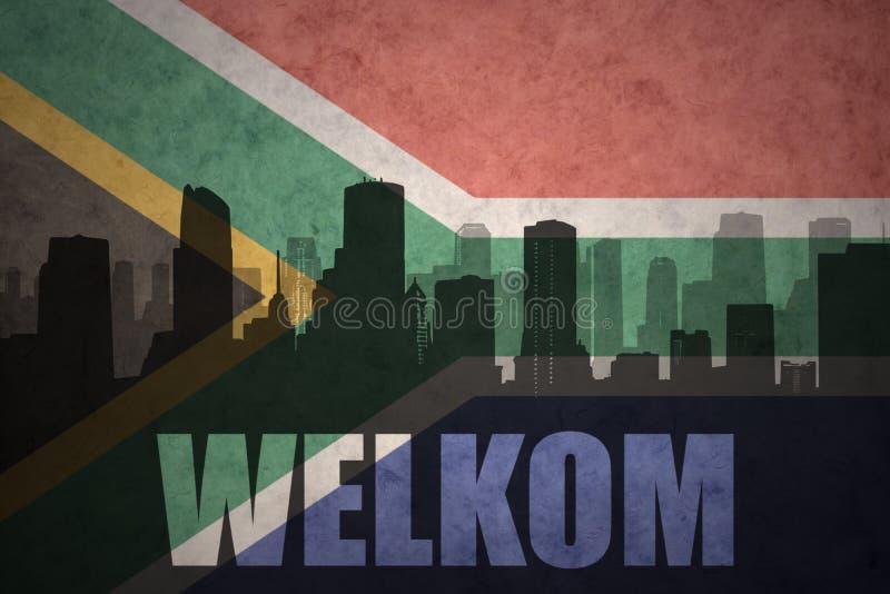 Siluetta astratta della città con testo Welkom alla bandiera d'annata della Sudafrica immagine stock libera da diritti