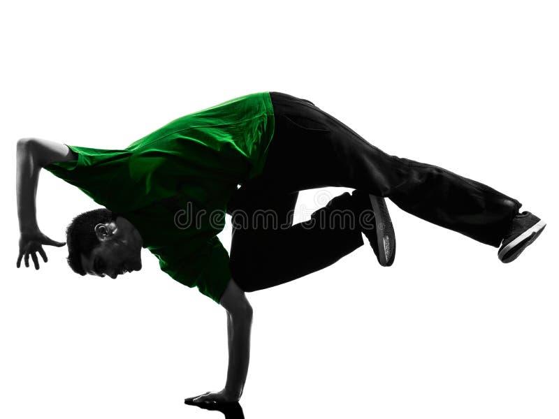 Siluetta breakdancing dell'uomo del giovane ballerino acrobatico della rottura immagine stock