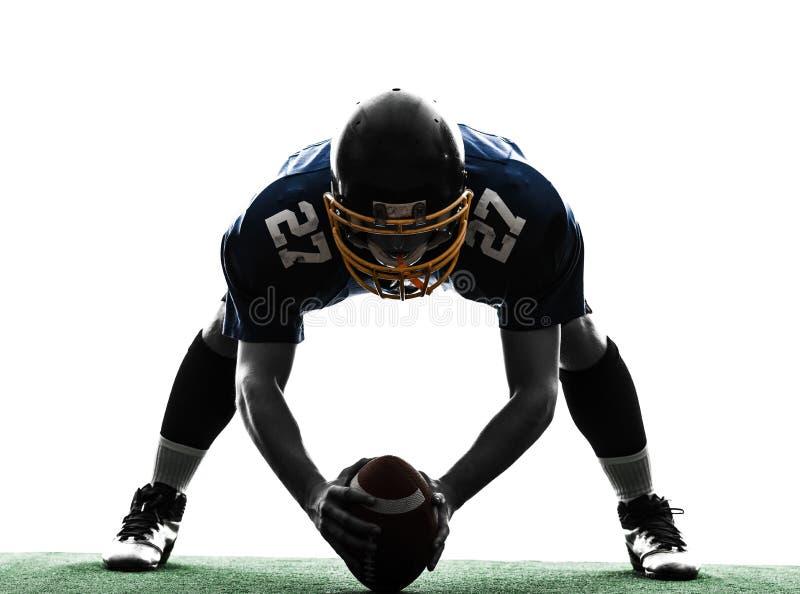 Siluetta concentrare dell'uomo del giocatore di football americano immagine stock