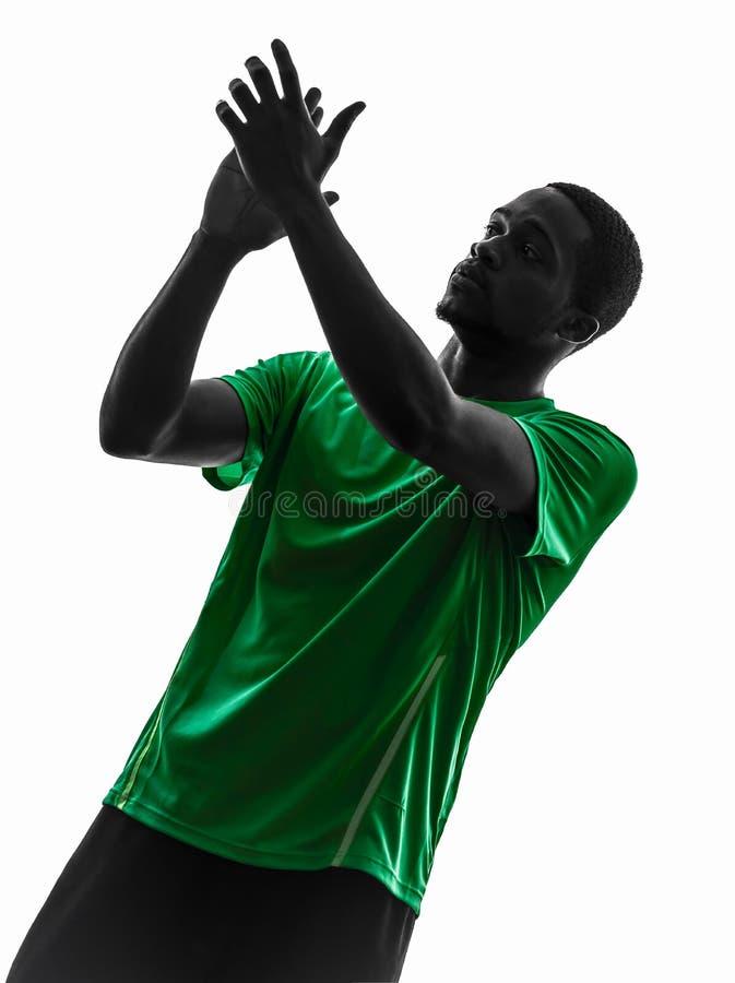 Siluetta d'applauso del calciatore africano dell'uomo fotografia stock libera da diritti
